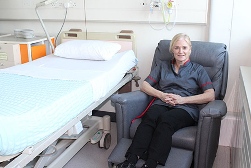 Lois Mortimer, Senior Midwife for inpatient services at Cardiff and Vale University Health Board in one of the new chairs