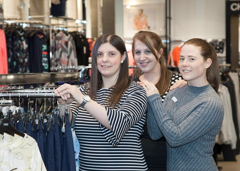 Staff in NEXT at Eagles Meadow in Wrexham. Pictured in store are: Laura Jones - Women's Wear Co-Ordinator, Store Manager Caroline Collinson and Deputy Manager Sarah Young