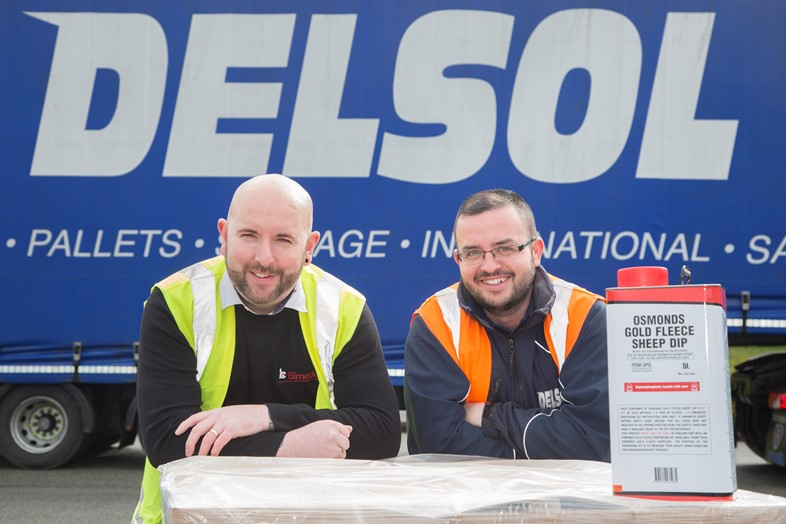 Delsol driver taking delivery of items from Bimeda, which are distributed under Delsol's Hazchem licence.  Pictured is Steve Jones operations Manager at Bimeda , Llangefni withDelsol driver Paul Kavanagh.