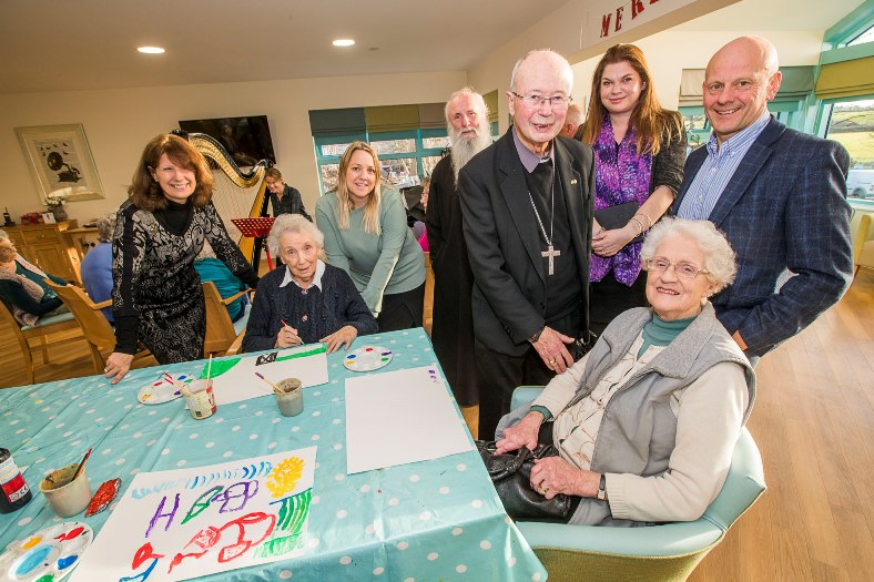 Bryn Seiont Newydd, Caernarfon. Father Deiniol and Bishop Edwin visited to give their blessing to the premises. Pictured from left, Gill Kreft, resident Mic Foster, Nia Davies Williams, manager Sandra Evans, Father Deiniol,  Bishop Edwin, Sarah Edwads, resident Daphne Egan and Mario Kreft.