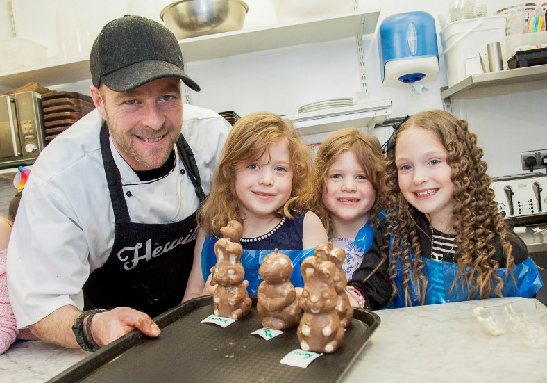 Hewitt's Cafe in Colwyn Bay hold chocolate themed events with choclatier and chef Stephen Hewitt running the workshops. Pictured: Stephen Hewitt in the workshop with Katie Evans, Connie Evans and Isabel Clifford