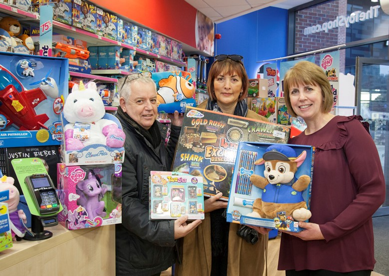 The Entertainer at Eagles Meadow in Wrexham have donated £750 to the Charity Nicola's Fund raised by local customers donating at the till on their debit cards when purchasing toys. Pictured: Steve and Debbie Riley along with Assistant Manger Vicky Smallwood