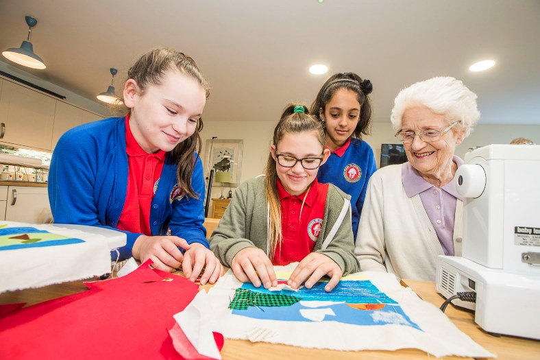 Artist Cefyn Burgess with school children from Ysgol Hendre working on the Patagonia project with residents at Bryn Seiont, Caernarfon residenst Daphne Egan with pupils, from left, Sian Williams, 11, Mia Gardner, 10 and Maryam Khan, 10.