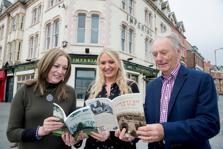 Pictured outside one of the Ministry of Food offices in Colwyn Bay are Authors Cindy Lowe, and Graham Roberts, along with Anna Openshaw  (CENTRE) of the Colwyn Bay BID organisation which is organising a 1940s festival and exhibition. and are appealing for people to submit memorabilia for an exhibition to be featured as part of the festival.