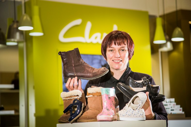 Clarks at Eagles Meadow, Wrexham are shoe recycling for Africa and have been very successful. Manager Lynn Vallance is pictured with some of the shoes.