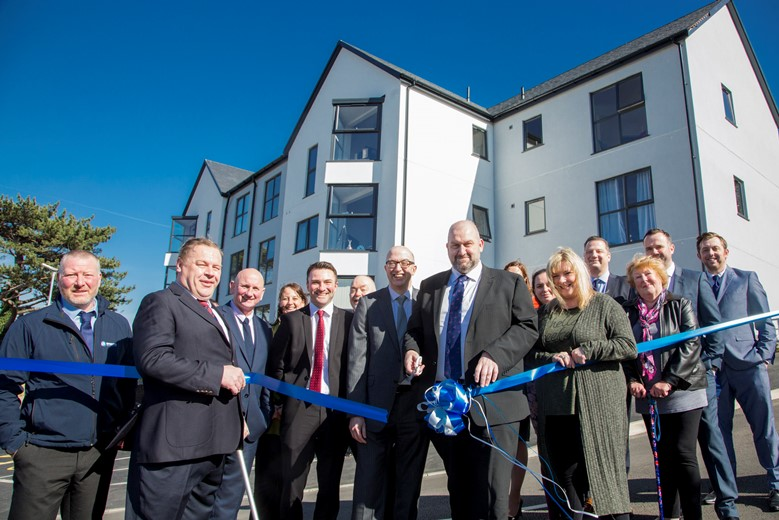New Cartrefi Conwy housing development, Maes Glanarfon, Penmaenmawr Road, official opening by Carl Sargeant Cabinet Secretary for Communities and Children. Pictured is Cabinet Secretary Carl Sergeant cutting the ribbon with Gwynne Jones Operations manager Cartrefi Conwy and  residents William Lewis Legge and Jane Jones holding the ribbon.