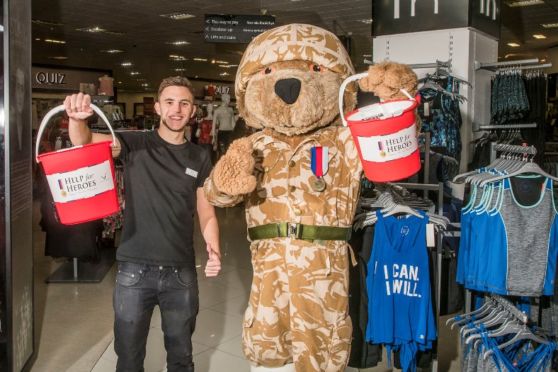 Debenhams at Eagles Meadow are raising funds for Help the Heroes and staff member Rhys Llloyd is pictured with the mascot
