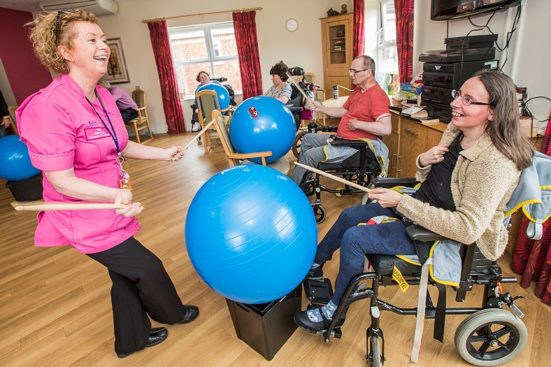 Pendine Park Enrichment team member Elaine Lee has found an entertaining way to keep residents for after seeing a video on YouTube inolving residents drumming to music. Elaine with resident Denise Drury
