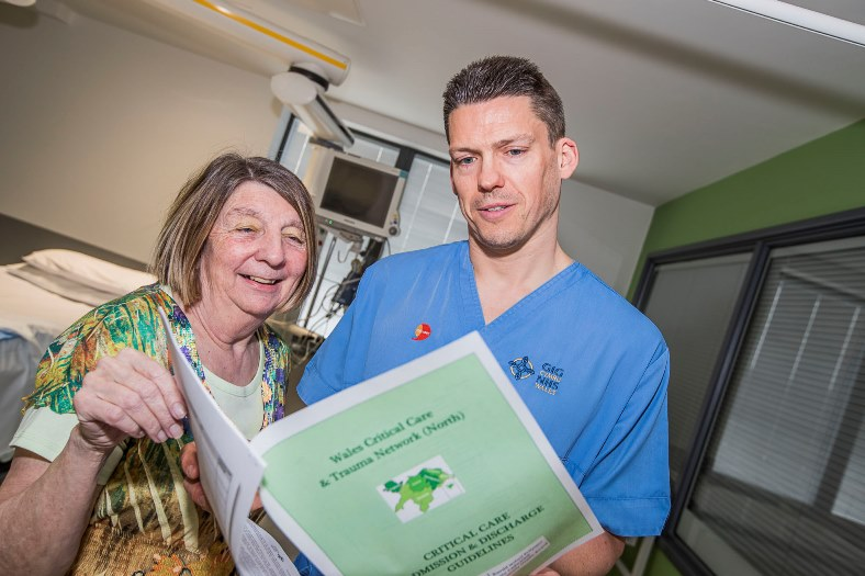 Carol Cooper, who was treated in the Intensive Care Unit at Glan Clwyd Hospital unit for heart problems visits the unit and meets Rhys Tudur, a cardiac specialist nurse, who helped look after her and looks through the new new critical care guidelines.