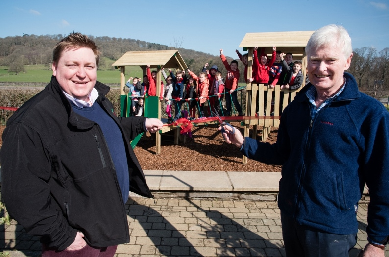 David Esser, Creative Play Sales Director and Lord Newborough officially open the new play area at the Rhug Estate, Corwen.