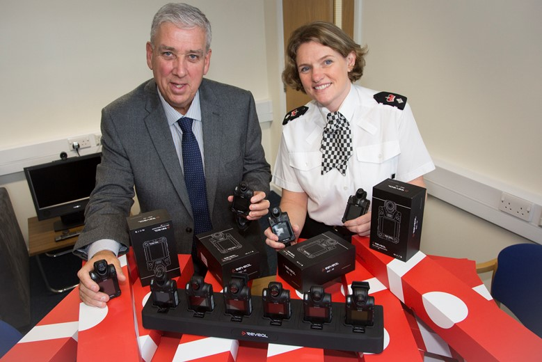 POLICE CRIME COMMISIONER NORTH WALES... Pictured are Arfon Jones, police and crime commissioner for the North Wales and Superintendeent Sasha Hatchett with some of the extra Body Cameras.